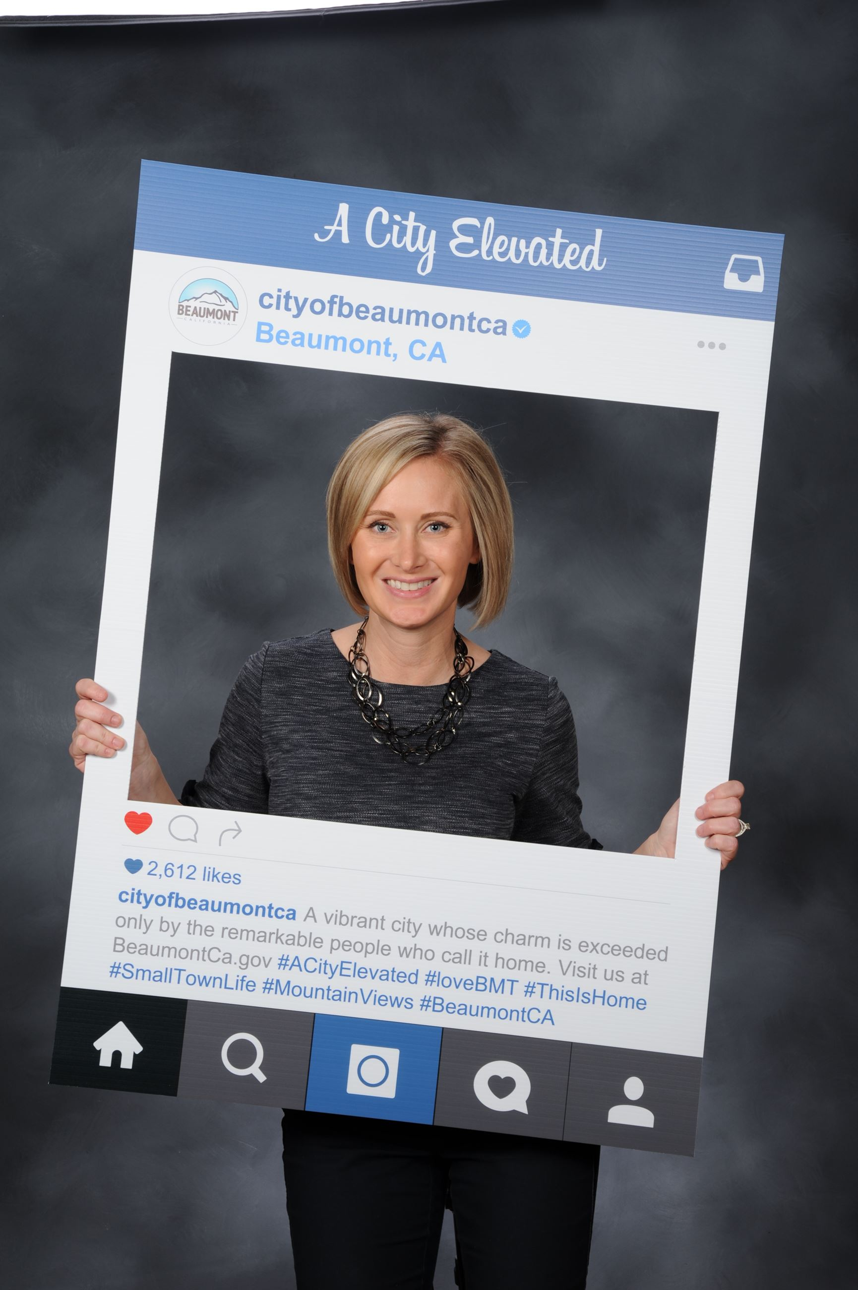 Photo of PIO Ashley Starr holding Instagram picture frame
