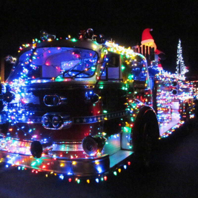 Photo of fire truck with Christmas lights on it