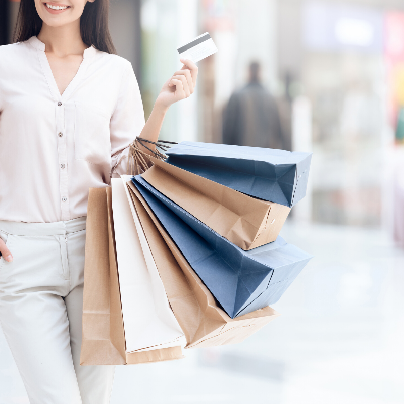Photo of women carrying shopping bags and a credit card